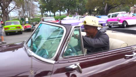 Classic-old-cars-are-driven-through-the-colorful-streets-of-Havana-Cuba