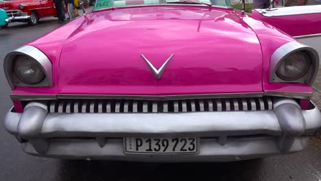 Classic-old-cars-are-driven-through-the-colorful-streets-of-Havana-Cuba-3