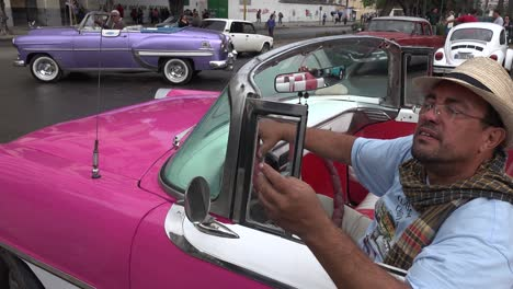 Classic-old-cars-are-driven-through-the-colorful-streets-of-Havana-Cuba-4