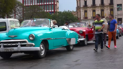 Classic-old-cars-are-driven-through-the-colorful-streets-of-Havana-Cuba-7