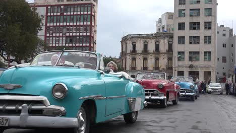 Classic-old-cars-are-driven-through-the-colorful-streets-of-Havana-Cuba-8