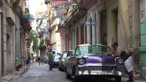 Establishing-shot-of-the-colorful-streets-of-Old-Havana-Cuba-with-classic-old-car-foreground