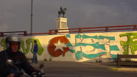 Revolutionary-propaganda-art-along-a-road-in-Havana-Cuba