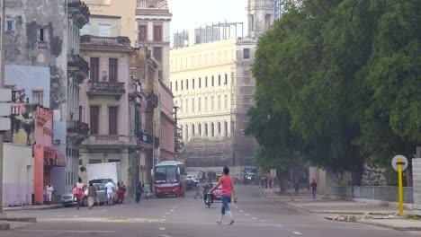 Old-cars-travel-along-amain-boulevard-in-old-Havana-Cuba