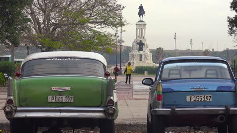 The-General-Maximo-Gomez-statue-near-the-Museum-of-The-Revolution-with-classic-cars-Havana-Cuba