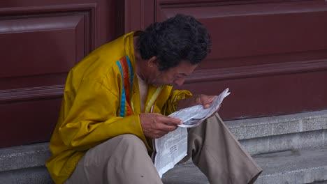A-Cuban-man-reads-a-newspaper-on-the-streets-of-Havana