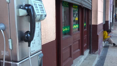 A-public-telephone-along-the-street-in-Havana-Cuba