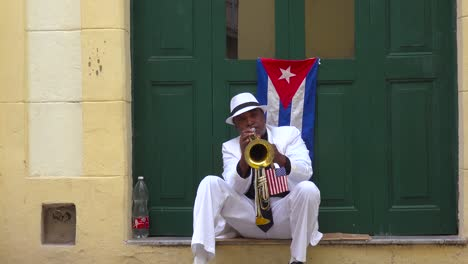 A-musician-plays-a-trumpet-on-the-streets-of-Havana-Cuba