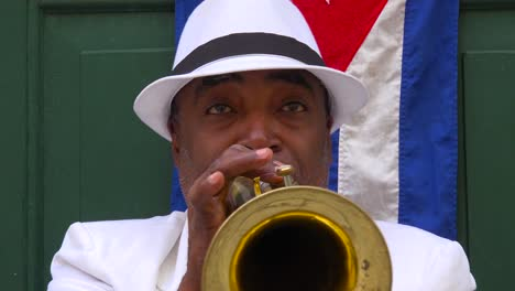 A-jazz-musician-plays-a-trumpet-on-the-streets-of-Havana-Cuba-1