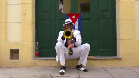 A-jazz-musician-plays-a-trumpet-on-the-streets-of-Havana-Cuba-2