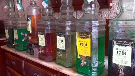 Old-fashioned-bottles-of-oils-and-perfumes-line-a-shop-stall-in-the-old-city-of-Havana-Cuba