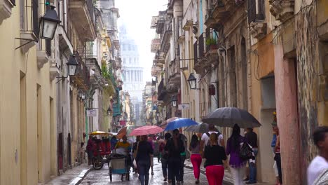 Crowds-of-people-walk-on-the-streets-of-Old-Havana-Cuba-in-the-rain