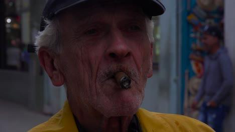An-old-man-smokes-a-cigar-on-the-street-in-Havana-Cuba