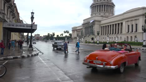 Classic-old-cars-and-horse-carts-are-driven-through-the-colorful-streets-of-Havana-Cuba-1