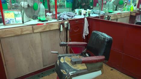 An-empty-barber-chair-in-a-barber-shop-in-Havana-Cuba