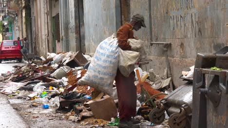 A-man-collects-garbage-along-the-streets-of-Havana-Cuba