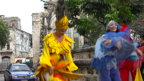Women-in-colorful-costumes-dance-on-stilts-on-the-streets-of-Havana-Cuba