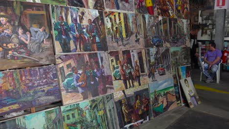 Artists-display-their-paintings-in-a-tourist-gallery-in-Havana-Cuba