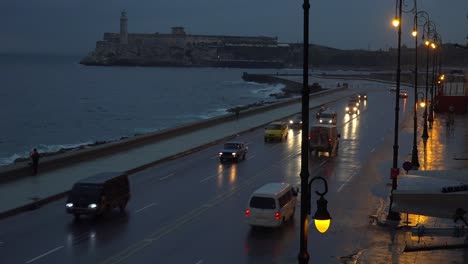 Beaytiful-shot-of-cars-traveling-on-the-waterfront-Malecon-in-Havana-Cuba-at-night-1