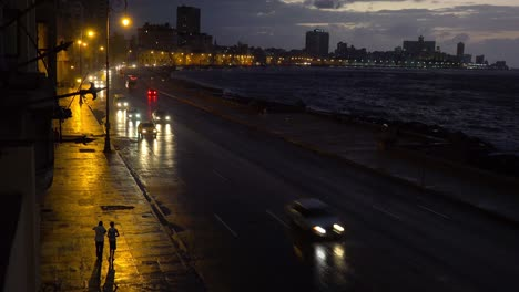 Beautiful-night-shot-of-the-malecon-in-Havana-Cuba-with-cars-passing
