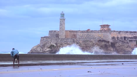The-Morro-castle-and-fort-in-Havana-Cuba-with-large-waves-foreground-3