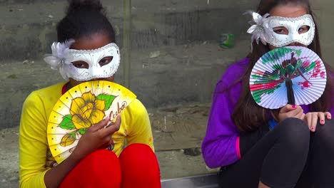 Children-dress-in-Mardi-Gras-style-masks-on-the-streets-of-Havana-Cuba