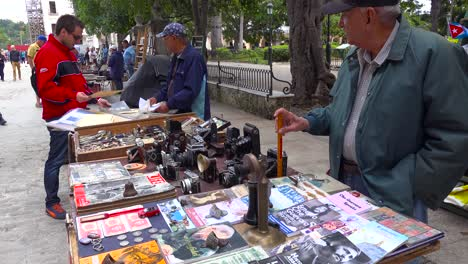 Vendors-on-the-streets-of-Havana-Cuba-sell-old-cameras-radios-and-propaganda-books-and-posters