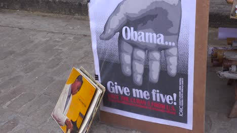 Vendors-on-the-streets-of-Havana-Cuba-sell-old-propaganda-books-and-posters-and-one-saying-Obama-give-me-five-