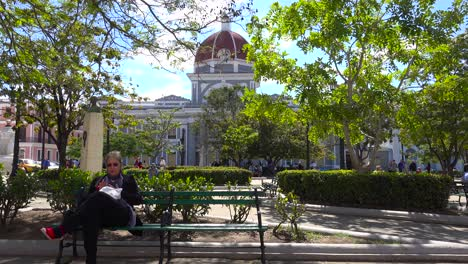 People-enjoy-a-sunny-day-in-the-park-in-Cienfuegos-Cuba
