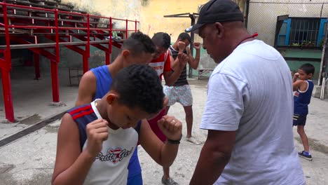 A-retired-boxer-gives-boys-lessons-in-the-old-city-of-Havana-Cuba-1