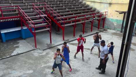 High-angle-as-a-retired-boxer-gives-boys-lessons-in-the-old-city-of-Havana-Cuba