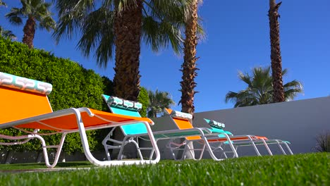 Colorful-lawn-chairs-sit-around-a-pool-at-a-Palm-Springs-home-1