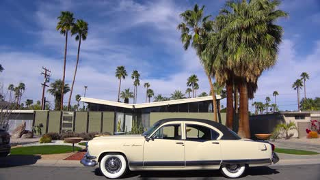 Exterior-establishing-shot-of-a-Palm-Springs-California-mid-century-modern-home-with-classic-retro-cars-parked-outside-2