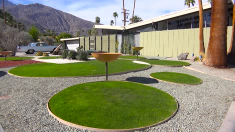 Exterior-establishing-shot-of-a-Palm-Springs-California-mid-century-modern-home-with-classic-retro-cars-parked-outside-5