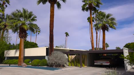Exterior-establishing-shot-of-a-Palm-Springs-California-mid-century-modern-home-with-classic-retro-car-parked-in-garage-1