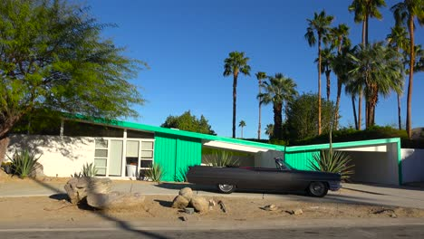 Exterior-establishing-shot-of-a-Palm-Springs-California-mid-century-modern-home-with-classic-retro-cars-parked-outside-6