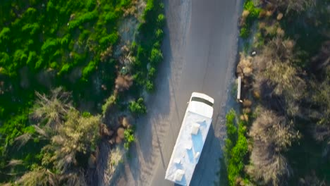 Aerial-directly-above-a-motorhome-traveling-on-a-country-road