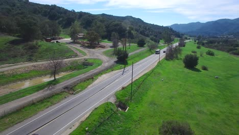 Aerial-of-a-motorhome-traveling-on-a-country-road