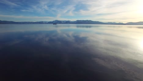 A-beautiful-aerial-shot-over-Lake-Tahoe-in-winter-with-a-paddlewheel-steamboat-in-distance-1