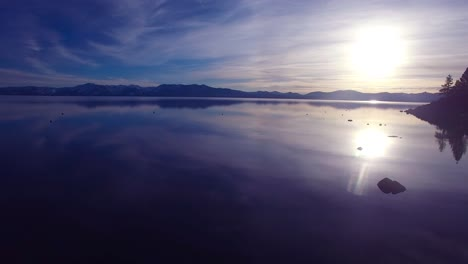 A-beautiful-aerial-shot-over-Lake-Tahoe-with-the-shoreline-in-silhouette-1