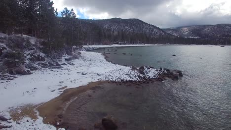 An-aerial-over-the-snow-covered-shores-of-Lake-Tahoe