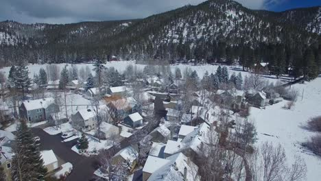 An-aerial-over-a-snow-covered-village-in-the-Sierra-Nevada-mountains