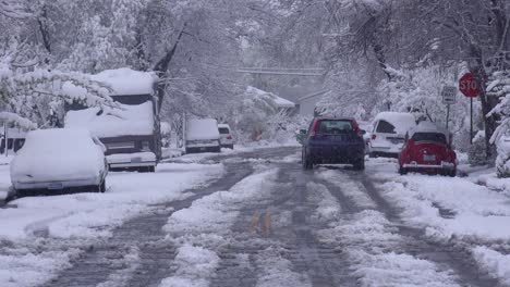 Traffic-moves-down-icy-and-snow-covered-roads-during-a-major-blizzard