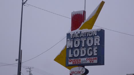 A-snow-covered-sign-reads-Vacation-Motor-Lodge