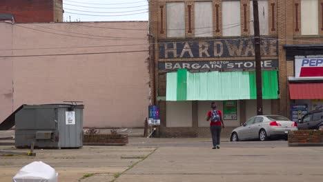 A-young-african-american-girl-walks-through-downtown-Selma-Alabama
