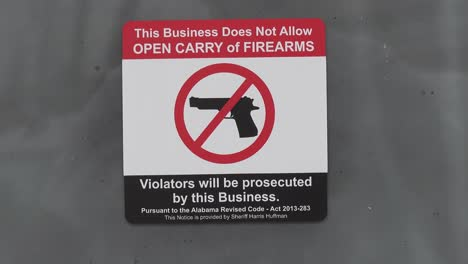 A-posted-signs-bans-the-bringing-of-guns-or-firearms-into-a-business