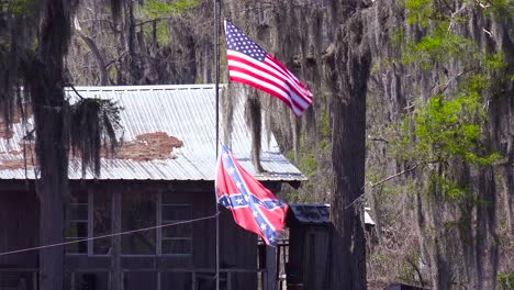 A-rundown-old-bayou-house-flies-a-Confederate-Flag-in-rural-deep-South