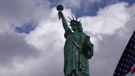 A-patriotic-shot-of-the-Statue-Of-Liberty-against-a-cloudy-sky