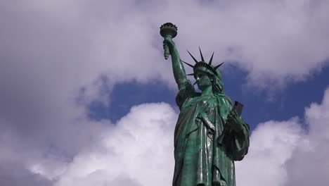 A-patriotic-shot-of-the-Statue-Of-Liberty-against-a-cloudy-sky-1