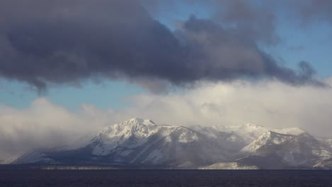A-time-lapse-shot-of-clouds-moving-over-the-snow-covered-mountains-of-Lake-Tahoe-in-winter